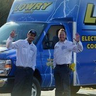 Lowry employees waving in front of truck