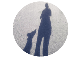 Shadow of dog and woman