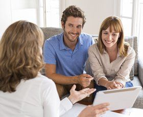 Couple during a consultation with an agent