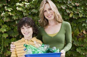 Woman and kid with recyclable plastic bottles
