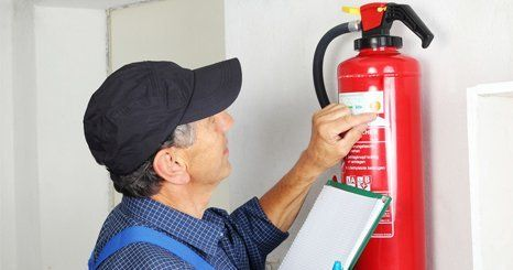 Man checking the fire extinguisher