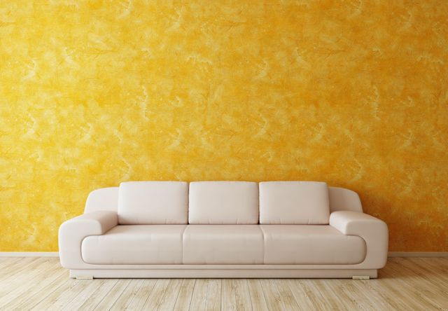 white couch, along yellow painted wall