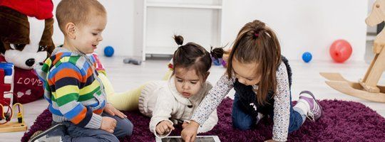 Children playing with ipad