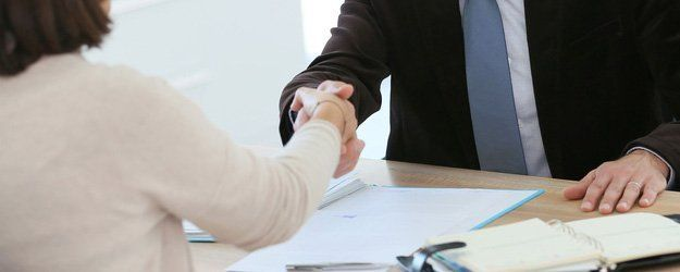 client shaking hands with lawyer