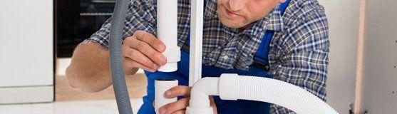Man repairing pipe