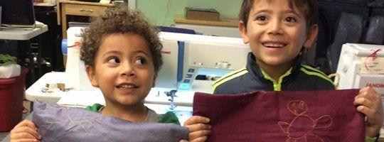 Kids holding bag