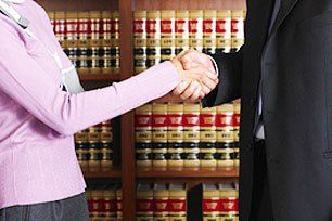 Injury woman giving shakehand for lawyer