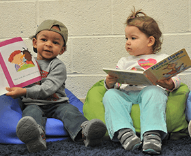children in learning center reading books