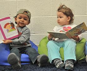 children in learning center reading books