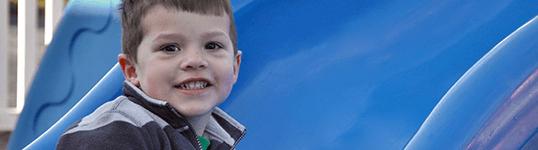 Smiling toddler on playground