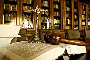 Law scale, gavel and library