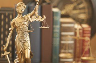 Lady justice and books