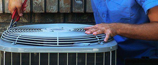 Man Fixing a air conditioner unit