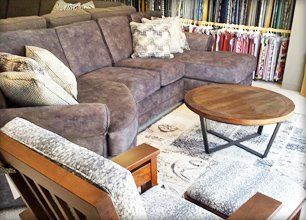 Purple sofa and wooden coffee table