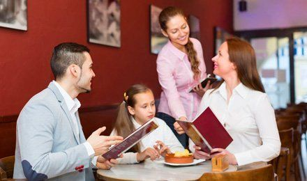 Family ordering a menu