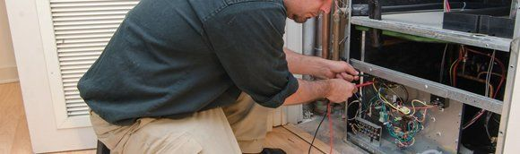 Professional repairing a HVAC system