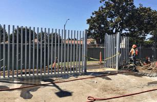 Man installing iron fence