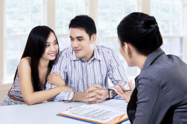 couple meeting with attorney