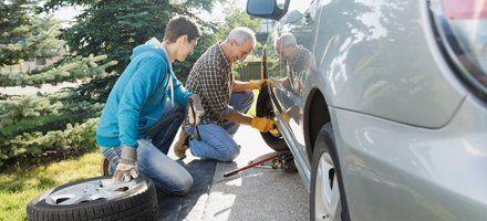 Men changing a flat tire