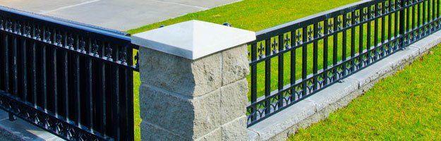Black anodized custom aluminum fencing with low brick pillar