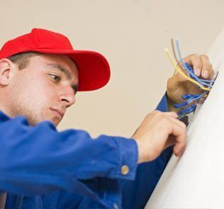 man repairing outlet