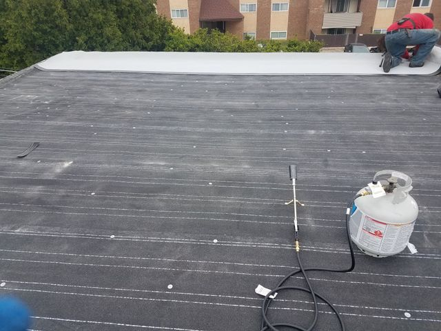 1st Choice Roofing Inc _ Roofing _ flat roof _ during