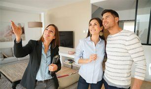 woman showing house to couple