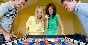People playing foosball