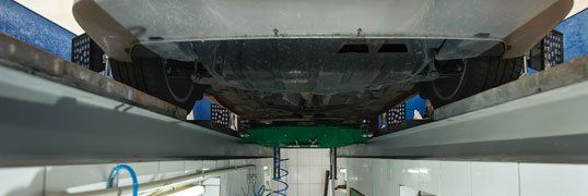 close up of underside of car from the inspection bay