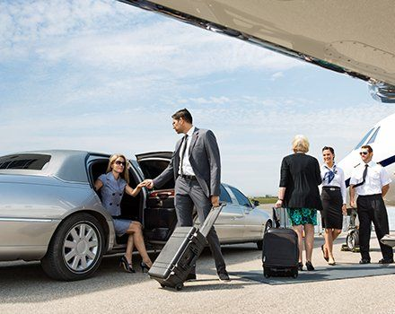 Woman Coming Out Of Limousine In The Airport