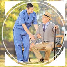 man assisting an elderly