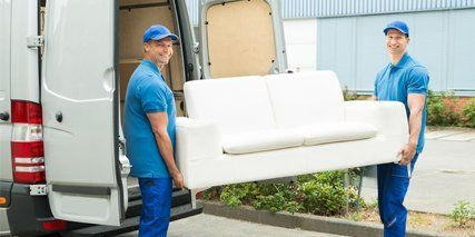 Men lifting a couch