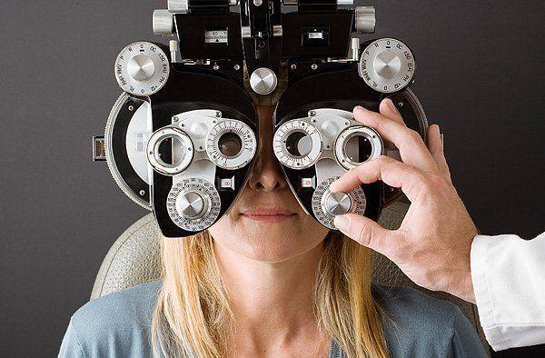 Woman having her eye examinations