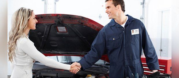 Woman shaking hands with mechanic