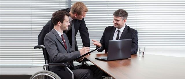 Disabled Man And Attorney with laptop